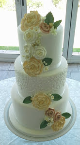 Vintage wedding cake with cascading roses