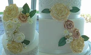 Close up of cascading moulded roses and accent sugar flowers
