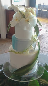 Three tiered contemporary wedding cake for a tropical inspired beach wedding