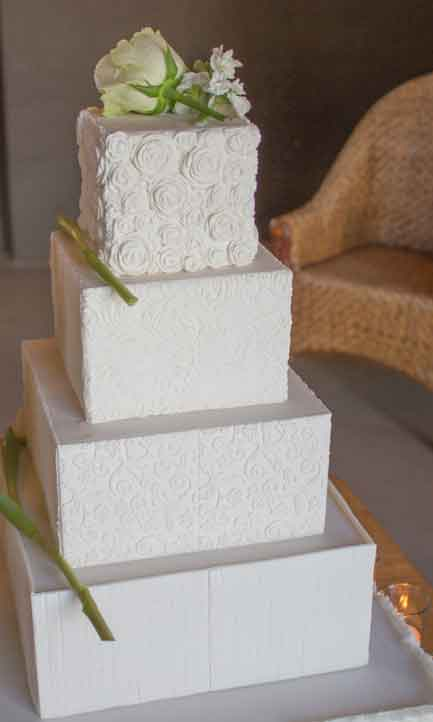 4 tier wedding cake with white textures